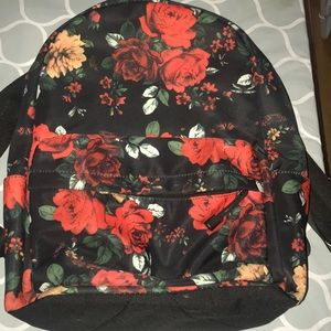A flower book bag with multiple pockets